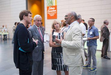 Artist Richard Mosse (left) chats with (left to right) former Duke University President Richard H. Brodhead, Nasher Board of Advisors Member Cynthia Brodhead and Duke Professor Richard J. Powell. Photo by J Caldwell.