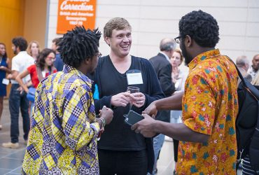 Artist Richard Mosse chats with visitors at the Nasher Museum during the opening event. Photo by J Caldwell.
