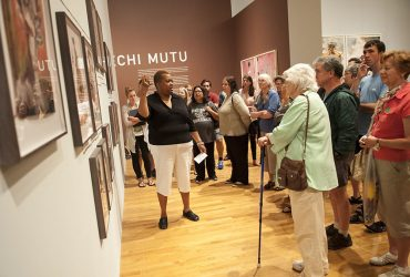 Artist Stacy Lynn Waddell gives a gallery talk about Wangechi Mutu's work. Photo by J Caldwell.
