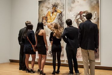 Duke students take a closer look at a work on paper by Wangechi Mutu. Photo by J Caldwell.