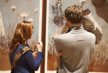 Visitors enjoy work by Wangechi Mutu. Photo by J Caldwell.