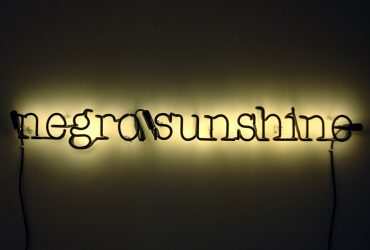 "A neon sign spells out ""negro sunshine"""