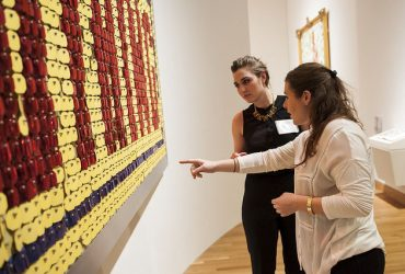 Duke students take a closer look at the work by Jack Pierson, Nothing (Yellow, Blue, Red). Photo by J Caldwell.