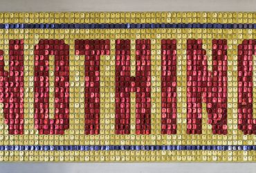 "The word ""NOTHING"" is spelled out with sequens in red capital letters on a gold background with blue border."
