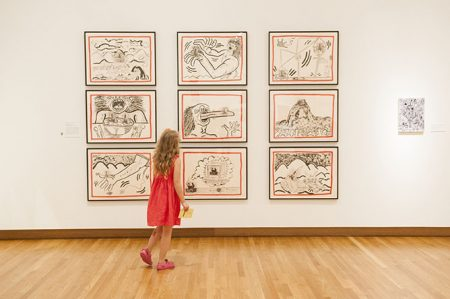 A young visitor takes in Keith Haring's works on paper. Photo by J Caldwell.