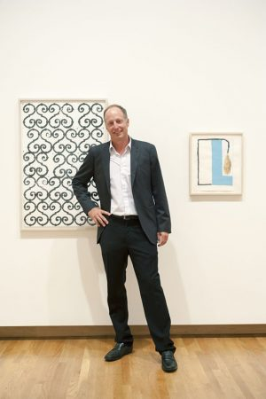During a gallery tour, Rubell stops to talk about Christopher Wool's 1988 untitled work. Photo by J Caldwell.