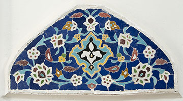 Iranian (Isfahan), Lunette (detail), 1938-39. Stonepaste: monochrome-glazed, assembled as a mosaic; 11 ¼ x 22 ¾ x 3 ½ inches (28.6 x 57.8 x 8.9 cm). © 2011, Doris Duke Foundation for Islamic Art, Honolulu, Hawai'i. Photo by David Franzen.