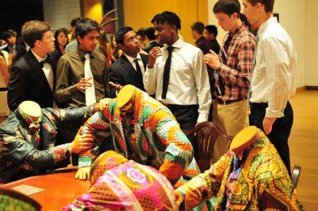 Students crowd around Shonibare's work