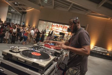 Grammy Award-winning producer and DJ Ninth Wonder spins music at the opening event. Photo by J Caldwell.