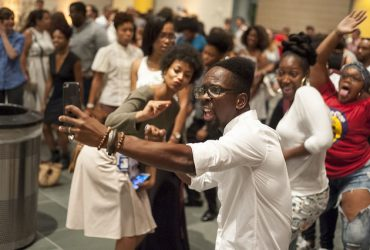 Artist Fahamu Pecou takes a selfie while dancing during the opening event. Photo by J Caldwell.