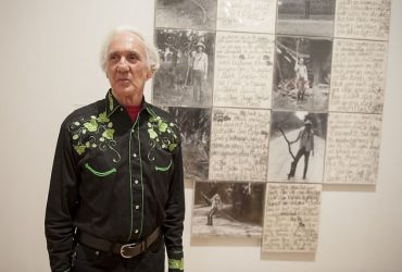 Artist Jim Roche poses in front of his work, Return to Florida, All in My Background: Piece, which has been acquired for the Nasher Museum's collection. Photo by J Caldwell.