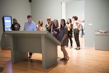 Visitors' faces light up from the interactive displays that tell stories of Jacopo de' Barbari's View of 1500.
