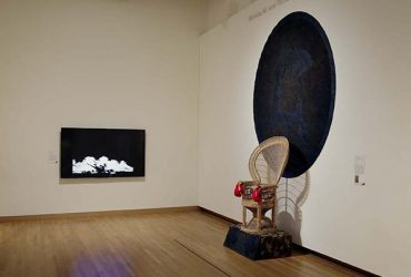 Installation view of Area 919 exhibition, featuring a sculpture (right) by André Leon Gray, What Does Revolution Sound Like?, created in 2010, and a video (left) by Hong-An Truong, Explosions in the Sky (Điện Biên Phủ 1954). Photo by Peter Paul Geoffrion.