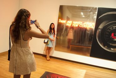 Duke students take photos with a work by Shimon Okshteyn, a Ukrainian artist. Photo by J Caldwell.