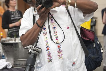 Artist Barkley L. Hendricks takes photos during the opening event for Southern Accent. Photo by J Caldwell.