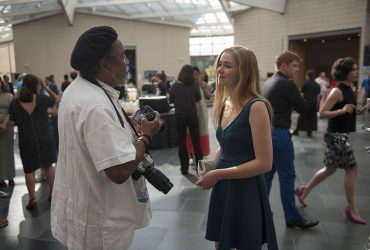 Artist Barkley L. Hendricks chats with young visitor Emma Livingston during the opening event. Photo by J Caldwell.