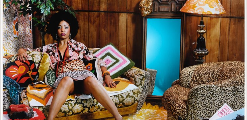 In this photograph, Thomas has carefully constructed a period setting inspired by her childhood, from patterned clothes and a wood-paneled background to the model's pose with legs slightly and suggestively open. Staring directly at the viewer and reminding us of popular Blaxploitation actresses like Pam Grier, Thomas's subject radiates sensuality and strength.