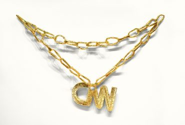 "In Necklace CNN, Hirschhorn creates a monumental necklace in the style of hip-hop ""bling"" using cheap and common materials. By constructing art out of what many people would consider trash, Hirschhorn not only provides commentary on what art is and where its value lies, but he also addresses issues of quality in popular culture. Enlarging the necklace to mammoth proportions draws attention to its gaudiness. As Hirschhorn states, ""Enlarging makes the thing empty."" The ""CNN"" on the necklace refers to the Cable News Network, with its twenty-four-hour news cycle that by necessity creates news when none exists, or repeatedly discusses the same topics until they are hollow words without meaning. Hirschhorn draws an analogy between ratings-conscious reporting and the posturing and social status implied by a piece of jewelry. He highlights the precarious nature of culture when influenced by a desire for the sensational."