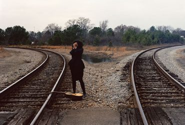 "Xaviera Simmons, Session One: Around The Y from the project Thundersnow Road, North Carolina, 2010. Color photograph. Commissioned by the Nasher Museum of Art at Duke University. Courtesy of the artist. With accompanying song, ""Two Tracks"" written by Austin McCutchen."