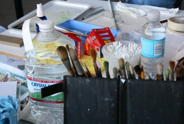 Brushes and other materials create a sort of still life in Barkley L. Hendricks's studio at Golden Belt in October 2009. Photo by Courtney Reid-Eaton.