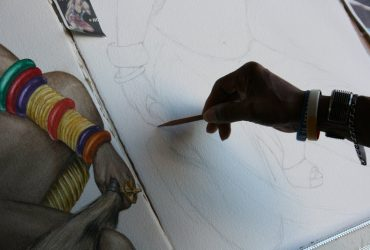 Barkley L. Hendricks works on a drawing in his studio at Golden Belt in October 2009. Photo by Courtney Reid-Eaton.