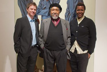 Chief Curator Trevor Schoonmaker with artists Mickalene Thomas and Barkley L. Hendricks in front of a painting by Barkley. Photo by J Caldwell.