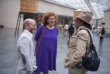 Susan Hendricks (middle) shares a laugh with Marshall N. Price (left) and Barkley L. Hendricks at the Nasher Museum in 2015. Photo by J Caldwell.