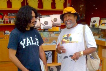 Artist William Cordova (left) hangs out with Barkley L. Hendricks at the opening event for The Record: Contemporary Art & Vinyl. Photo by J Caldwell.