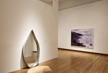 Installation view of All Matterings of Mind, with a sculpture by Pinaree Sanpitak on the left and a photograph by David Benjamin Sherry on the right. Photo by Peter Paul Geoffrion.