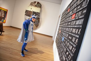 The Duke Blue Devil takes a closer look at Skylar Fein's Black Flag (For Elizabeth's), part of the exhibition Southern Accent: Seeking the American South in Contemporary Art. Photo by J Caldwell.