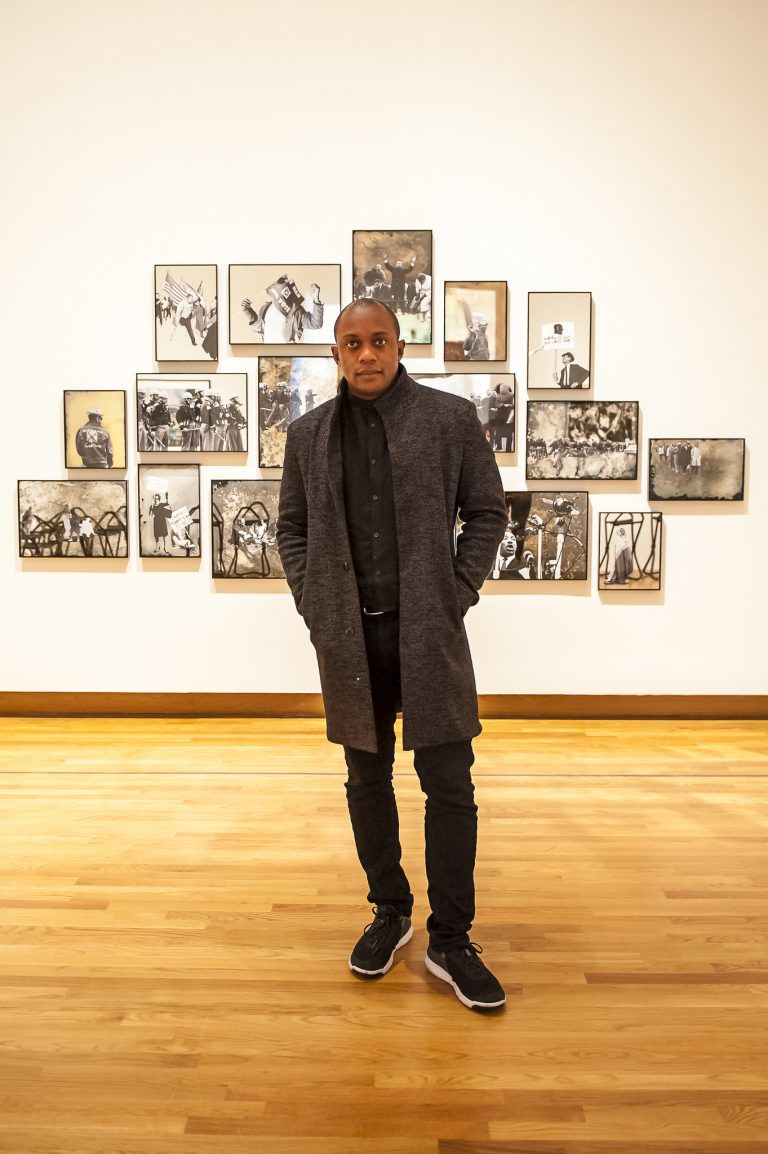 Hank Willis Thomas Poses With His Work Aint Gonna Let Nobody Turn Us