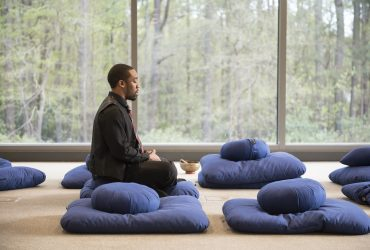 A Duke student takes part in a meditation exercise during a mindfulness event at the Nasher Museum to complement the exhibition All Matterings of Mind. Photo by J Caldwell.