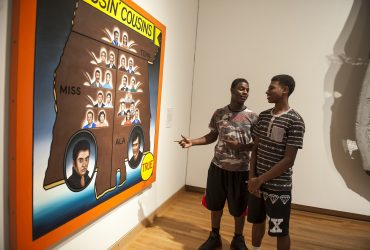 Duke students take a closer look at Roger Brown's work, Kissin' Cousins, part of Southern Accent: Seeking the American South in Contemporary Art. Photo by J Caldwell.