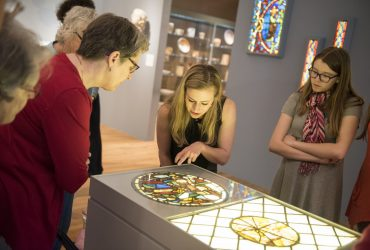 Visitors take a closer look at works of Medieval stained glass, recently renovated within The Collection Galleries. Photo by J Caldwell.