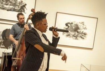 Durham artist shirlette ammons, drawing from her perspective as a North Carolina native, African American and queer artist, performs in the Incubator Gallery featuring Kara Walker: Harper's Pictorial History of the Civil War (Annotated). Photo by J Caldwell.