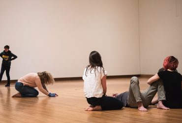Participants of Parliament stand, walk, lie down and otherwise navigate an empty gallery space, in silence, for six hours a day, over the course of four days, at the Nasher Museum. Photo by J Caldwell.