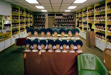 Alex Harris, Wig Shop, King Street, Charleston, South Carolina from the series Southern Color, October 1984 (printed 2018). Archival pigment inkjet print, Image: 22 x 27 inches (55.88 x 68.58 cm). Courtesy of the artist, Durham, NC.