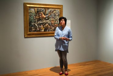 Ellen Raimond, assistant curator of Academic Initiatives at the Nasher Museum, with Reginald Marsh's Dali's Dream of Venus.