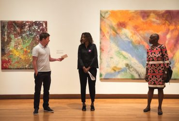 "Curator Trevor Schoonmaker introduces Duke professor Thavolia Glymph for a ""Noon at the Nasher"" tour"