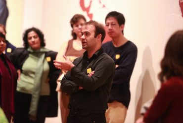 Pedro Lasch (front) gives a tour to visitors. Photo by J Caldwell.