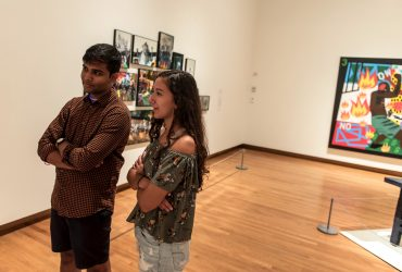 "Duke students discuss works or art ""People Get Ready."" Photo by J Caldwell."