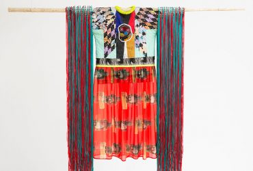 Jeffrey Gibson, Radiant Tushka, 2018. Repurposed quilt, assorted glass, plastic and stone beads, printed chiffon, nylon ribbon, canvas, acrylic paint, nylon fringe, copper, and artificial sinew, 95 ½ x 64 x 2 ½ inches (242.57 x 162.56 x 6.35 cm). Courtesy of the artist and Kavi Gupta, Chicago. Photography by Peter Mauney.