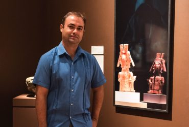 Artist Pedro Lasch poses with his work in Wilson Pavilion