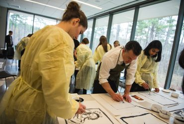Using ink on paper, participants create large gestural paintings as a warm-up to the day ahead. Photo by J Caldwell.