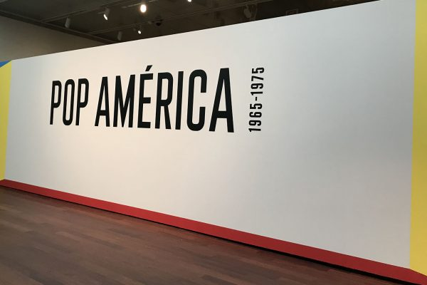 Entrance wall of Pop America: 1965-1975 at the McNay Art Museum in San Antonio, Texas.