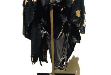 Marta Minujín, Frac-asado (Grilled-Tuxedo), 1975. Mixed-media dress on stand and metal crown of thorns, 62.5 inches (158.75 cm), overall. Estrellita B. Brodsky Collection. Image courtesy of the artist and Henrique Faria Fine Art, New York, New York, and Buenos Aires, Argentina.