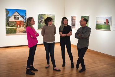 "Duke students (from left) Janie Booth (T'19), Brittany Halberstadt (T'19) and Jessica Chen (T'20), speak with artist Bill Bamberger in the ""Courtside"" exhibition."