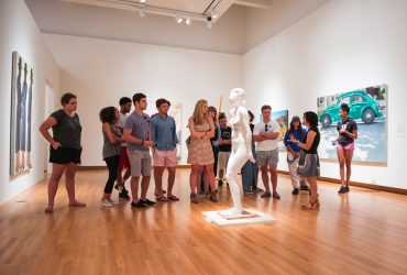 "Ellen C. Raimond, Ph.D. (Assistant Curator of Academic Initiatives), leads a tour for students in the ""Disorderly Conduct"" exhibition."