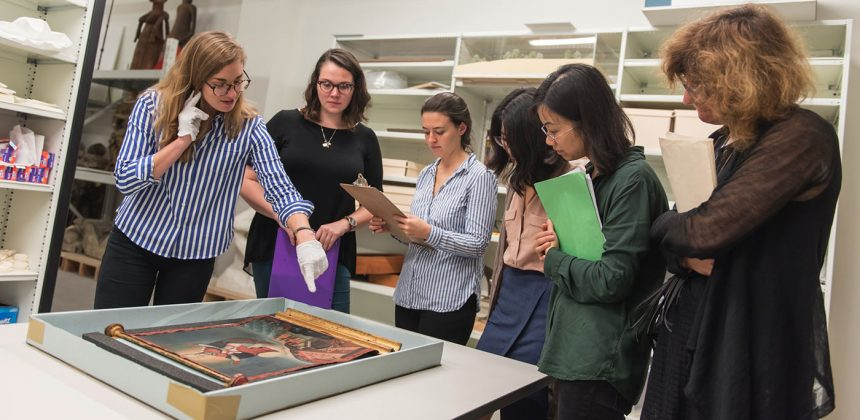 Susanna Caviglia, assistant professor of Art, Art History, & Visual Studies, brings graduate students in her course, 18th-Century Art and Architecture, to examine the scroll with Julia K. McHugh, Ph.D. (far left), Trent A. Carmichael Curator of Academic Initiatives at the Nasher Museum. Photo by J Caldwell.