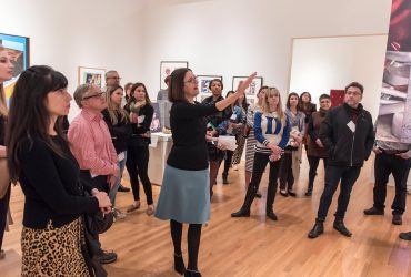 Guest Curator and Duke Professor Esther Gabara leads a media preview tour through Pop América. Photo by J Caldwell.